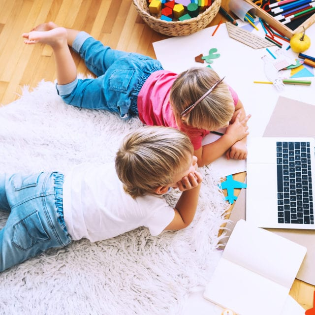 montessori at home children learning remotely on laptop with hands on activities - american montessori academy montessori school in chicago il